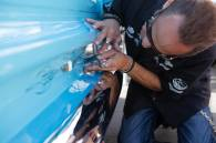 Von Hot Rod laying down some smooth lines on Darryl Dier's Powder Blue 1964 Chevy C10 Stepside Truck.