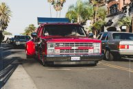 "Brett Oakes and Rojo Grande who took home 'Best Truck""strolling downtown Huntington Beach."
